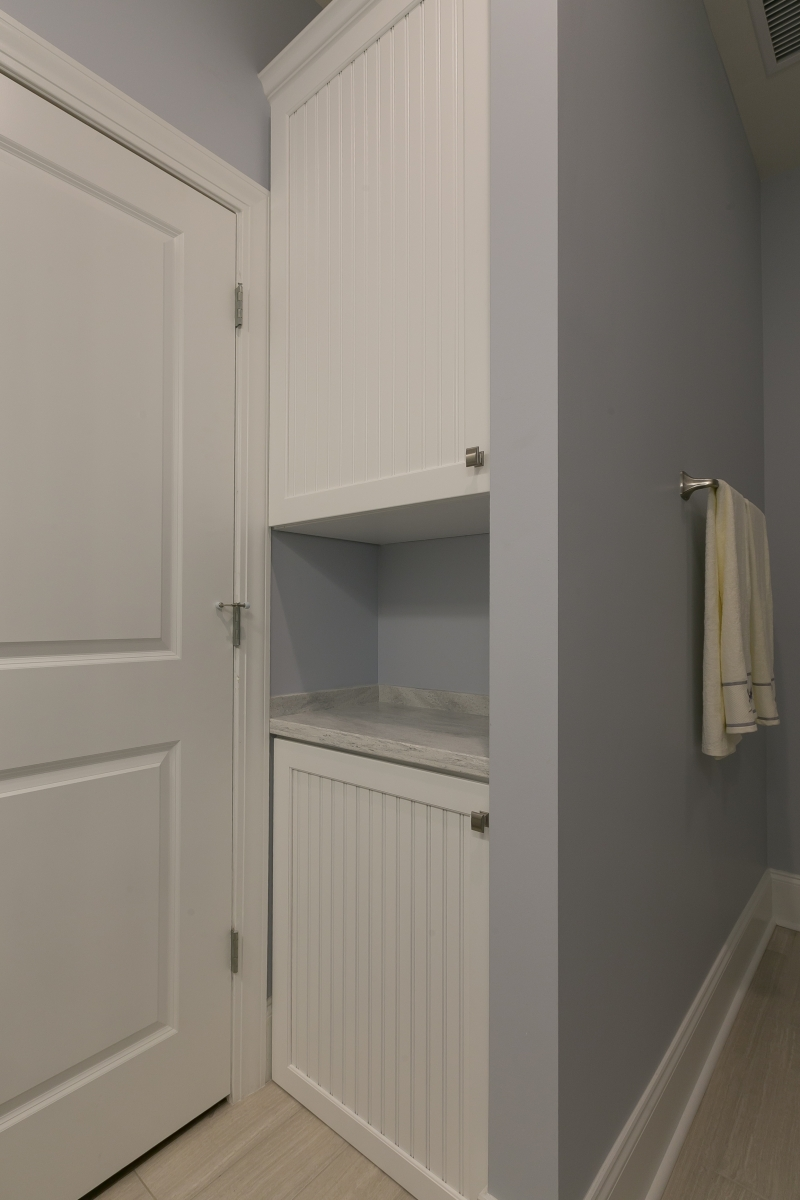 Bathrooms dynamic design - Linen cabinet with laundry hamper ...